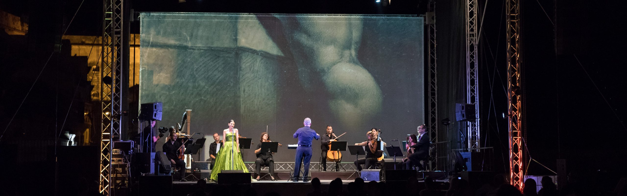 Michael Laus directing a classical music concert in Malta